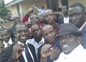 Celebrating victory outside Bombo police station